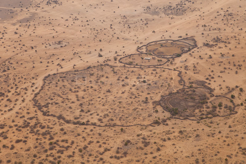 Aerial view of Maasai fenced homestead, with buildings and livestock enclosures. Kenya, Africa, August 2009
