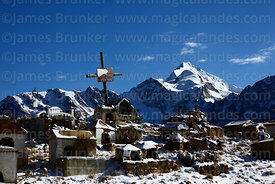 Cross in Milluni cemetery commemorating miners killed on 24th May 1965, Mt Huayna Potosi in background, Cordillera Real, Bolivia