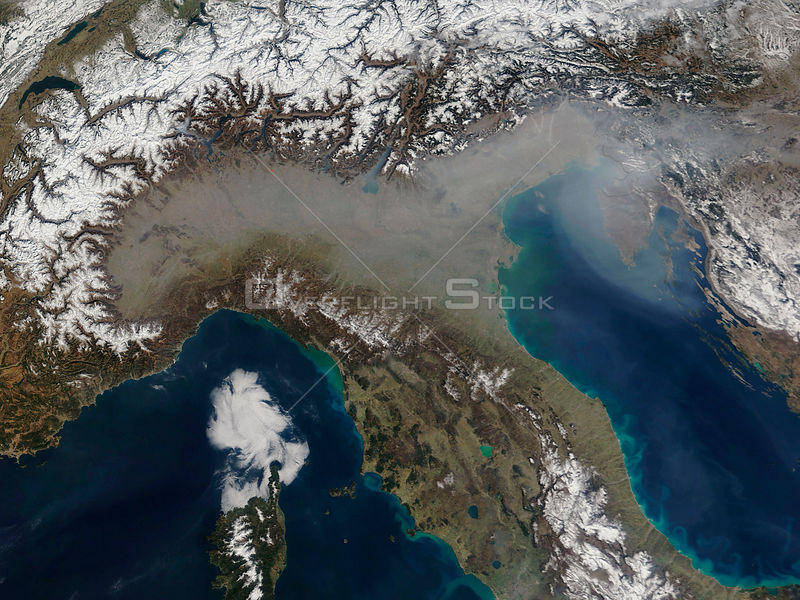 EARTH The Alps -- 17 Mar 2005 -- A grey veil of haze covers the Po River Valley of northern Italy and stretches out over the Adriatic Sea in this true-color satellite image