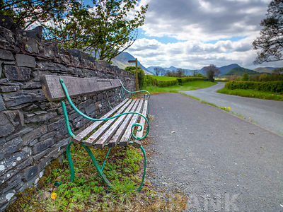 Bench by the countryside road