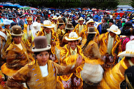 Ch'utas dancing with cholitas at San Antonio de Abad festival in Caquiaviri, Bolivia