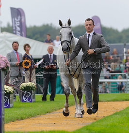 Harry Dzenis and XAM - The first vets inspection (trot up),  Land Rover Burghley Horse Trials, 3rd September 2014.