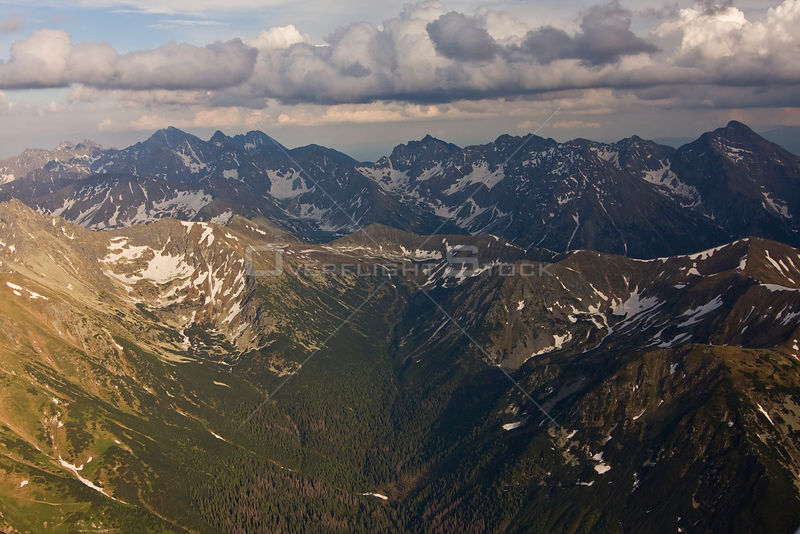 Aerial view of the end of Ticha valley and the High Tatras with Mount Krivan (2,495m) on the right and Mount Gerlach (2,655m) in the background, Western Tatras, Carpathian Mountains, Slovakia, June 2009