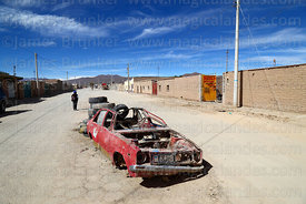 Wrecked car abandoned in middle of street, Uyuni, Bolivia