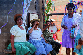 Women playing caja (drum) and drinking chicha (maize beer), Canasmoro, Tarija Department, Bolivia