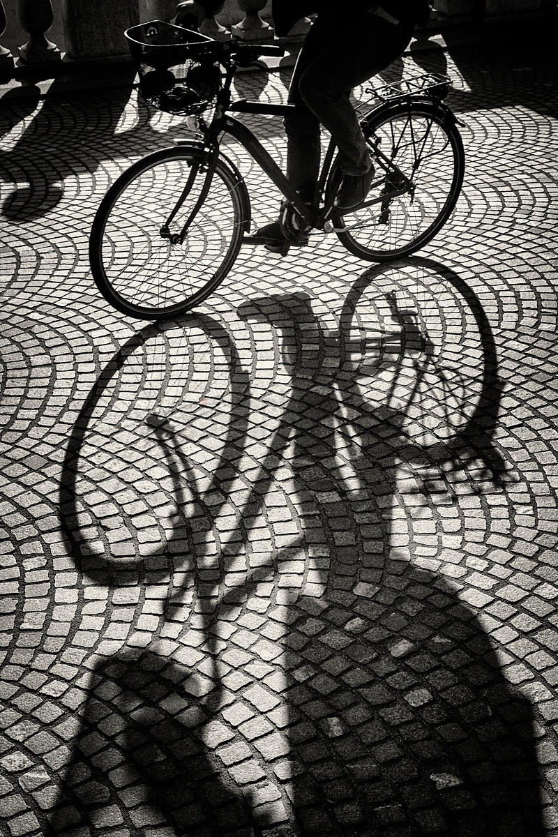 Shadows of a Cyclist Crossing the Triple Bridge