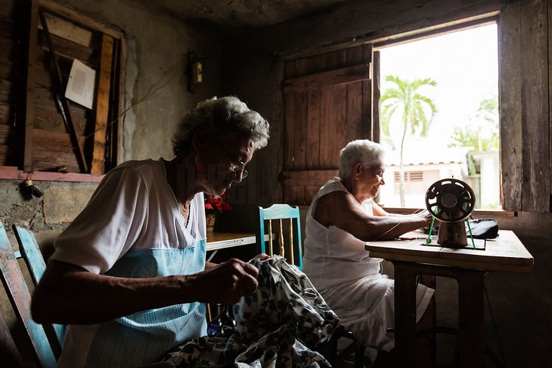 Elderly Women Sewing in a Home