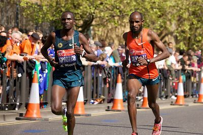 Stephen Kiprotich (12th) of Uganda and Ibrahim  Jeilan of Ethiopia Running in the Virgin Money 2014 London Marathon
