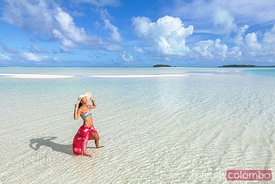 Beautiful woman in Aitutaki lagoon, Cook Islands