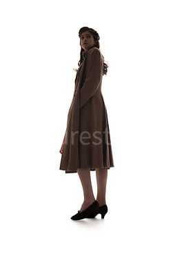 A 1940's woman standing, in semi-silhouette – shot from low-level.