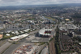 Manchester aerial photograph looking across from Manchester United Stadium towards Salford Quays with Manchester City in the background