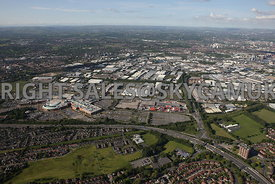 Manchester aerial photograph of Trafford Park looking from across the M 60 motorway and Junction 9 with the Trafford Centre and looking down the Parkway in towards the centre of the Industrial Estate