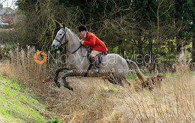 John Holliday jumping a ditch - The Belvoir at Burton Pedwardine