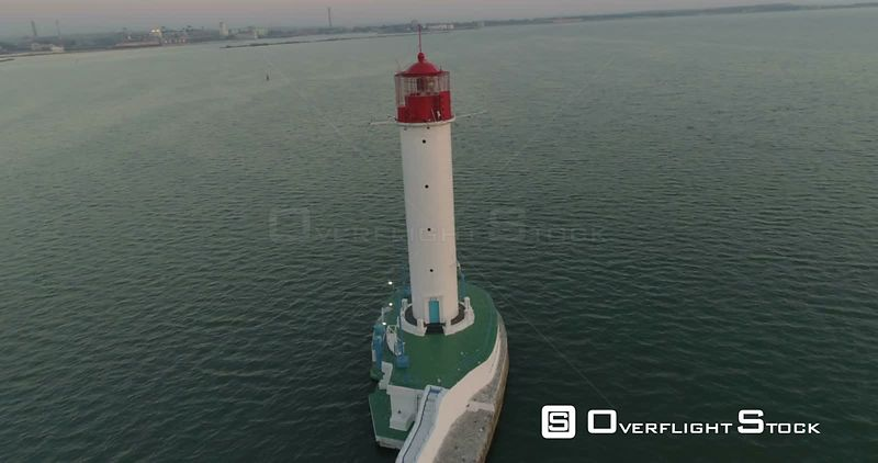 Drone flies around the Odessa Lighthouse at dawn. The port of Odessa is seen behind. Ukraine