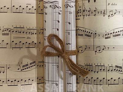Scrolls of sheet music on musical notation book