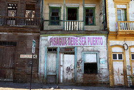 "Banner saying ""Pisagua should be a port"" on abandoned building , Pisagua , Region I , Chile"