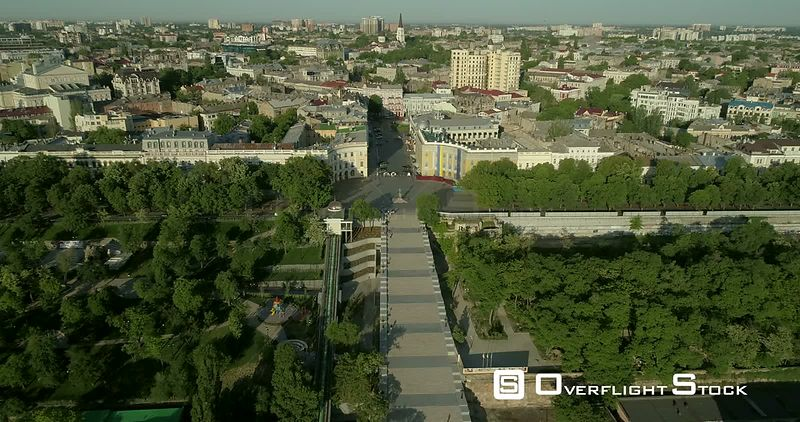 Aerial camera flies high above the Potemkin Stairs in Odessa Ukraine before tilting towards the Duc Richelieu statue on Prymorski Boulevard Ukraine