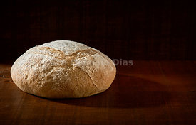 Fresh Baked Rustic Bread on Wooden Background