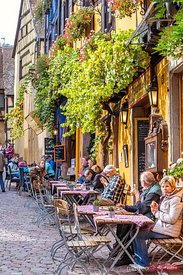 People at coffee tables, Riquewihr, Alsace, France