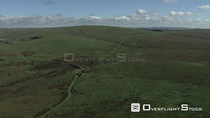 Aerial view tracking over West Moor, with a disused railway line, Dartmoor National Park, Devon, England, UK, October 2015.