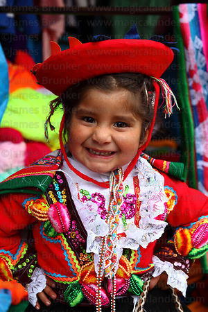 Girl wearing traditional dress at festival , Paucartambo , Cusco Region , Peru