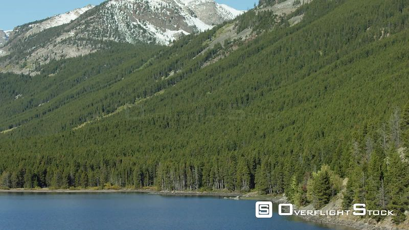 Dense forests and towering snowcovered peaks surround Mystic Lake, in the Beartooth mountain Range in southwest Montana