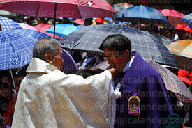 Devotee of Señor de los Milagros receiving holy communion after central mass, Virgen de la Candelaria festival, Puno, Peru