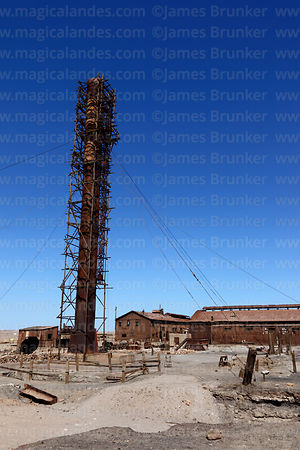 Chimney and processing plant of abandoned nitrate mining town of Humberstone, Region I, Chile