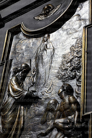 Detail of bronze relief of Virgin Mary ascending to heaven on main entrance of cathedral, La Paz, Bolivia