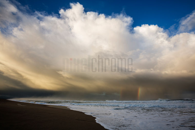 Storm Clouds Above a Beach at Dawn