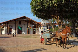 Horse and cart in main square in front of Jesuit Mission church, San Ignacio de Moxos, Beni, Bolivia