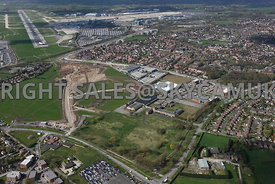 Ringway Trading  Estate, Shadowmoss Road, Old Ferranti factory and Atlas Business Park Simonsway with Manchester Airport in background showing terminal buildins and runways