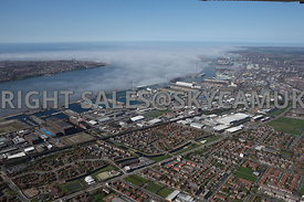 Liverpool aerial photograph looking from Vauxhall area of Liverpool out towards the banks of low lying cloud and fog over the River Mersey and Liverpool Docks