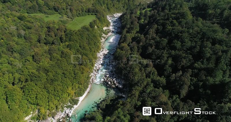 Mountain rapids, C4K aerial drone view above a turquoise soca river, near Trigolov national park, on a sunny summer day, in the Julian alps, Slovenia
