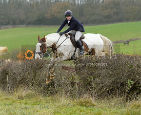 Kitty King jumping a fence - The Cottesmore Hunt at Manor Farm