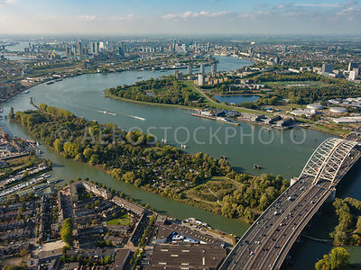 Island of Brienenoord, the Brienoordbrug, the Nieuwe Maas and above in the picture Rotterdam.