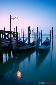 Row of gondolas at sunrise in Venice, Italy