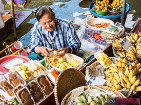 Old thai woman working at floating market, Bangkok
