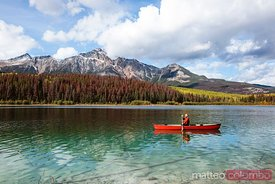 Man canoeing on lake, Jasper National Park, Canada