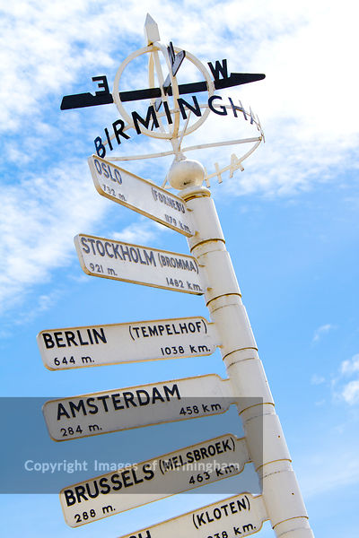 Finger post at Birmingham Airport, highlighting distance to international destinations. England, UK