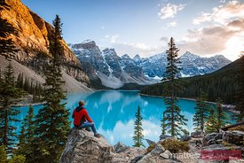 Man looking at Moraine lake, Banff, Alberta, Canada