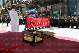 Mining workers union members parade past the remains of Eduardo Abaroa during official events for Dia del Mar / Day of the Sea, Plaza Avaroa, La Paz , Bolivia