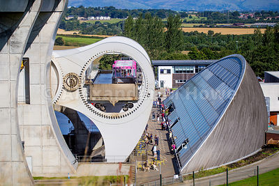 The Falkirk Wheel rotating with views across open Countryside
