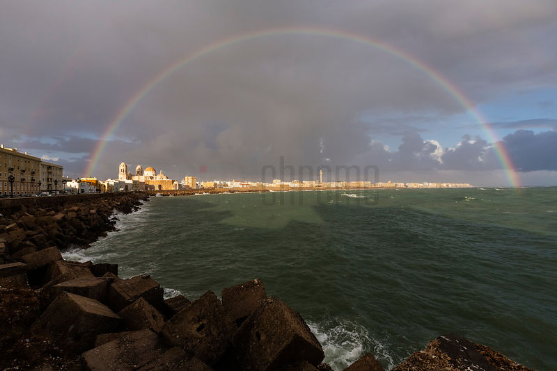 Skyline of Cadiz from the Sea Wall with a Full Rainbow