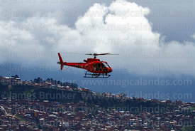 Bolivian Air Force (FAB) Eurocopter AS 350 B3 Ecureuil above La Paz suburb on hillside, Bolivia