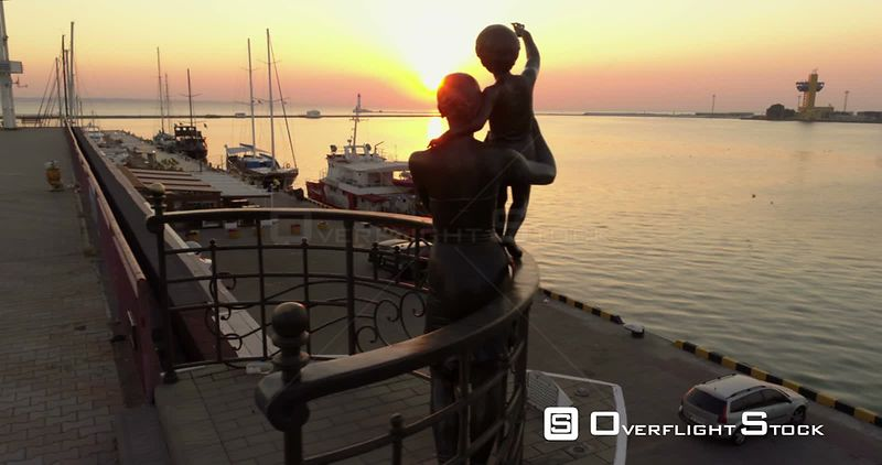 Drone flies at low level past the statue of the seafarers at the Odessa cruise terminal in Ukraine. Ukraine