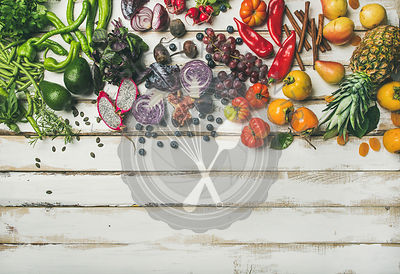 Flat-lay of fresh fruit, vegetables, greens and superfoods, copy space
