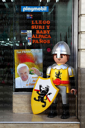 Poster for visit of Pope Francis in shop window, La Paz, Bolivia