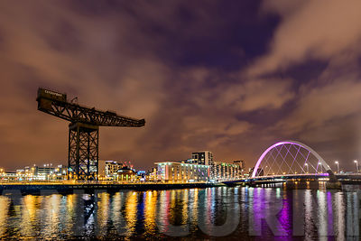 GLASGOW, SCOTLAND - NOVEMBER 27, 2015: The Finnieston Crane and Clyde  Arc Bridge on the river Clyde in Glasgow AT NIGHT..