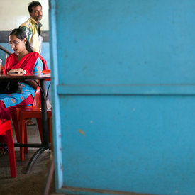 A man glances at a woman customer at the Indian Coffee House, Thrissur